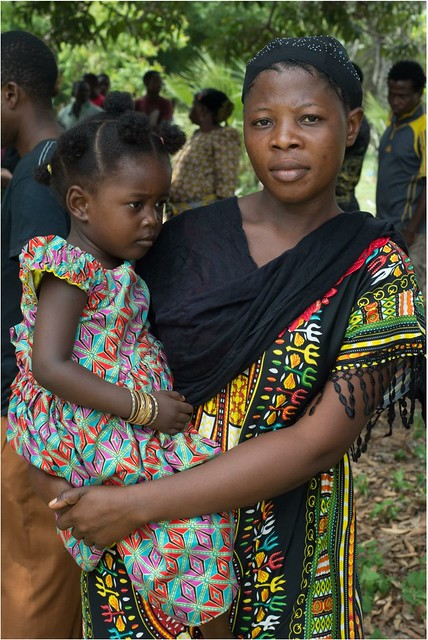 Mother carrying daughter-1