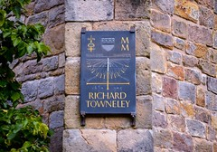 Richard Towneley Sundial (rustyruth1959) Tags: nikon nikond3200 tamron16300mm alamy uk lancashire burnley towneleyhall towneleypark richardtowneley sundial richardtowneleysundial astronomer johnflamsteed astronomerroyal greenwich royalobservatory solareclipse 1676 1676solareclipse outdoor rainfall mm 2000 latitude longitude time timepiece slate crest familycrest buttress wall stonework alansmith commission southbuttress tree greenery leaves leaf letters text words writing gold