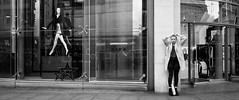 Manchester 069 (Peter.Bartlett) Tags: manchester bag niksilverefex shopfront window shopping people reflection facade doorway urbanarte urban unitedkingdom door shopwindow lunaphoto streetphotography girl standing candid uk ricohgr woman peterbartlett bw eyecontact monochrome blackandwhite noiretblanc city england gb