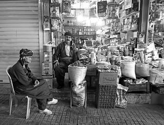 Local men sit by a bazaar stall, Sulaymaniyah / Iraqi Kurdistan