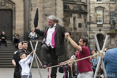 On The Tightrope (DMeadows) Tags: dmeadows davidmeadows davidameadows edinburgh fringe 2017 festival scotland uk street performance performer performances performers acts act entertainment entertaining person people man tightrope walk walking rope suit elderly knot tension tamronspaf90mmf28dimacro