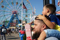 Shoulder Ride (dtanist) Tags: nyc newyork newyorkcity new york city sony a7 konica hexanon 40mm brooklyn coney island boardwalk denos wonder wheel park labor day shoulder ride ferris popcorn