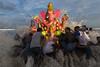 Ganesh Idol Immersion, Chennai, India (Ravikanth K) Tags: chennai tamilnadu india ind ganesh visarjan immersion water sea beach people festival travel splash waves statue idol ganapati vinayaka god lord culture outdoor force 500px groupofpeople men light