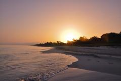 Sunrise over Varadero (Wandering Ilíara) Tags: nikon d90 cuba varadero ocean water beach sea blue sun sand waves sunrise dawn travel holiday adventure sky