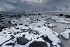 NEwards view-Ytresand beach-Sandbotnen bay. Flakstadtinden-Digertinden-Storklauvan-Hustinden-Bjorntinden-Montinden-Hornet mounts. Moskenesoya-Flakstadoya-Lofoten-Norway. 0408 (rweisswald) Tags: coast bay beach seaside rockyshore seashore foreshore cove inlet bight ytresand yttersand sandbotnen fredvang estuary sandelva sandoya view landscape seascape white snowy snowfall snowblanket snowcovered snowcappedmountain storm stormysky cloudy overcast misty darkwater sea wave peak moskenesoya flakstadtinden blekktinden andopshesten digertinden storklauvan hustinden gauktinden bjorntinden montinden hornet flakstadoya lofoten nordlandfylke norway