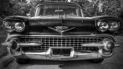 '58 Cadillac (vwcampin) Tags: iphoneography iphoneographer iohoneology iphonology rusty patina retro cool 1950s 50s auto automobile death vehicle greaser vintage antique old chromegrill headlights midwest omaha nebraska florence wymanheights transportation car frontend grill chrome 58 1958 hearse caddie caddy cadillac