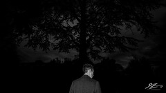 Chris, what is it? (Tim van Zundert) Tags: monochrome blackandwhite selfportrait depression loneliness borderlinepersonalitydisorder bpd mentalhealth memory behind backturned person tree night evening longexposure sony a7r voigtlander 21mm ultron