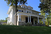 House — Urbana, Ohio (Pythaglio) Tags: house dwelling residence historic foursquare classical revival twostory balloon frame urbana ohio champaign county chp25211 threebay porch columns ionic volutes capitals entablature dentils denticulate windows modillions dormers grass slope trees sky blue