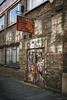 H Suskind, Wilkes Street, Spitalfields (louisberk.com) Tags: whitechapel spitalfields wilkesstreet factory sweatshop garments graffiti olympusxa fuji400h film