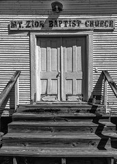 The Doors To Mt. Zion (Mike Schaffner) Tags: abandoned bw blackwhite blackandwhite burialground chapel church decay decayed derelict deserted dilapidated doors faded monochrome old ruins weathered wooden chester texas unitedstates us