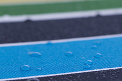 Drops on Stripes (brucetopher) Tags: umbrella striped colorful rain drop raindrop droplets droplet wet deckumbrella bump bumps texture lined lines lining pattern 7dwf