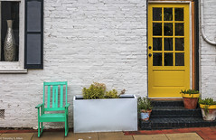 Yellow Torques and White (allentimothy1947) Tags: georgia newnan chair door facade wall color study yellow torques white building architecture downtown window brick decorative