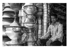the pot specialist (handheld-films) Tags: india hyderabad indian metal pots steel containers shop shopkeeper portrait portraiture people cities work street blackandwhite monochrome travel subcontinent