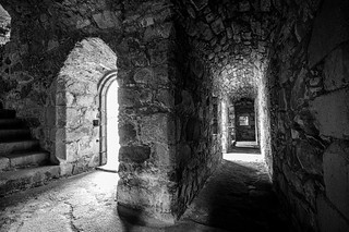 which way to go? to the light or down the passage? Fine art black & white, inside Tolquhon Castle, Aberdeenshire, Scotland