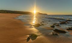 Sunburst Sunrise Seascape (Merrillie) Tags: daybreak shoreline sand landscape killcarebeach australia sunburst surf clouds nswcentralcoast centralcoast newsouthwales waves longexposure nsw water beach coastal centralcoastnsw rocks sea photography waterscape outdoors seascape dawn coast nature sky