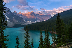 Moraine Lake (Bob C Images) Tags: lake sunrise moraine mountains skyclouds morning light trees forest boats canoes alberta canada sony landscapes