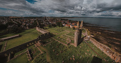 St Andrews (Mark Liddell) Tags: strulestower st rule rules tower cathedral historicscotland standrews fife scotland uk outdoor town traditional scottish historic ruins ruined abbey church cathedralofstandrew gate arch stone brick spire turret window blue sky clouds gothic architecture walls masonry grass edifice crumbling wide angle panorama view northsea sea quaint black white ultra ultrawideangle 14mm cliffs seaside rooftops skyline