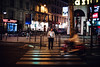 Waiting to cross, life speeds by (ewitsoe) Tags: nightcanon man waiting cross zebra standing moped speeds paris france lights evening street urban cityscape french europe stripes travel