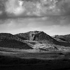 Dunes (Hannes Dannath) Tags: landscape bw clouds cloudy black white countryside valley hill dunes grassland hillside rolling hills