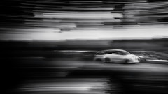 ...and off he sped (Dr Kippy) Tags: icm intentionalcameramovement bw blackandwhite mono monochrome car canoneosm eosm efm1855mm