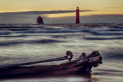 Weathered For The Better (matthewkaz) Tags: grandhaven pier grandhavenlighthouse lighthouse lakemichigan lake water greatlakes driftwood log tree wave waves winter sunset sky clouds nocatwalk michigan 2017