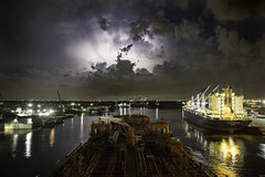 Downtown lightening (hp181san) Tags: houston texas maritime nautical lowlight availablelight ship tanker clouds night lightening harbor photogra houstonphotography canon5dmarkiii canon weather reflections seascape landscape cityscape downtownhouston portofhouston
