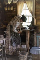 Morning Light Chores (jackalope22) Tags: lhf grinding wheat portrait living history farms girl