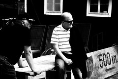 Whats up? (andersåkerblom) Tags: sunglasses shadow men monochrome streetphotography blackandwhite