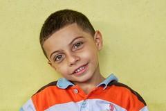 Honduran Boy Portrait (Pejasar) Tags: orange stripedshirt honduras seisdemayo student portrait boy