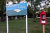 Book Box in Ladora 9-10-17 01 (anothertom) Tags: iowa ladora freelittlelibrary redbox bookbox localpark onawalk sign ingrahampark grass smalltown 2017 sonyrx100ii