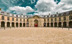 And we'll never be royals... (PokemonaDeChroma) Tags: royalstables versailles france ecurieduchateau building sand fence old history sky clouds canon eos 6d samyang 14mm
