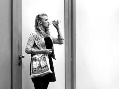 Paris in Berlin (d_t_vos) Tags: berlin paris eiffel woman youngwoman teenager girl drinking bag blond blonde white blackandwhite bw zwartwit silhouette door light reflection contrast street streetphotography streetportrait candid storkowerstrasse greifswalderstrasse grellstrasse dickvos dtvos prenzlauerberg prenzlauerallee