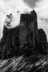 Tre Cime (Nobusuma) Tags: pentaxmx pentax smcpentax 50mm f17 24x36 italia italy dolomites dolomiti trecimedilavaredo monochrome blackandwhite bw caffenolcm selfdeveloped agfa agfaapx rocks clouds hiking hikinglife homemadesoup