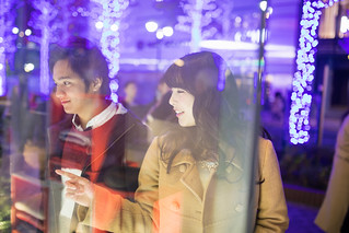 High school couple doing window shopping at Christmas night