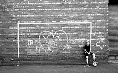 On the ball (plot19) Tags: jay kid boy male greatbritain family love blackwhite british britain england english north northern northwest now football portrait photography plot19 brick goal
