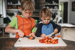 If I watch your kid, they learn to cook (Elizabeth Sallee Bauer) Tags: boy busy child childhood cook cooking cutting domesticlife family farm fun helping helpingout homesteading housework interior kid kitchen learning prep preparing qualitytime raising summer together togetherness tomatoes work