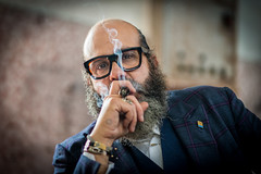 Stranger #74/100 Mattia (Mario Frassine) Tags: beard argang barber shop 100strangersproject 100strangers streetphotography street naturallight brescia humasofbrescia sunday market glass smoke cigar