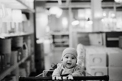 he'll always be the first, part three (manyfires) Tags: film analog henry baby boy child son nikonf100 35mm portrait ikea shoppingcart bw blackandwhite bokeh store shopping pdx portland oregon