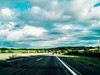 The flight of the bumblebee. (achterbahnmädchen) Tags: hungary road autobahn sky blue grey white clouds meadow green nature trees froest hills europe europa ungarn achterbahnmädchen street streets roads vanishingpoint fluchtpunkt