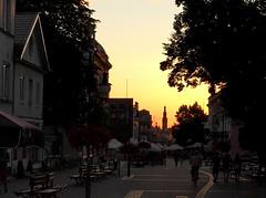 Evening in Radom (roomman) Tags: radom city town poland 2017 main high street run down walk walking evening sun sky sunset set night people shop shops