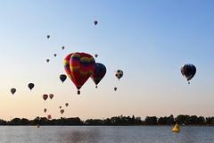 Enmasse (Patricia Henschen) Tags: balloonliftoff balloonclassic hotairballoon prospect lake memorialpark park prospectlake colorado coloradosprings downtown mountains mountain laborday labordayliftoff balloon balloons morning dawn