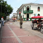 IMG_2734a - Female Soldier with Recruiting Office in the background - Iquitos, Loreto, Peru thumbnail