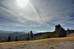 A View with Mountains and Trees and the Sun Shining Above... (thor_mark ) Tags: project365 blueskies cloudwisps cloudsabove cloudsacrossvalley colorefexpro craterlakenationalpark day3 douglasfir hillsides lookingeast mountains nikond800 viewfromduttonridge capturenx2edited bluesskieswithclouds partlycloudy sunny nature outside landscape oregon unitedstates
