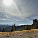 A View with Mountains and Trees and the Sun Shining Above... thumbnail