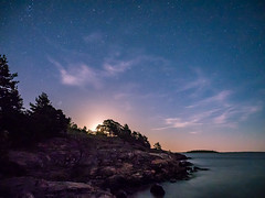 One Minute Past Midnight (Jens Haggren) Tags: moonrise stars clouds night sea seascape landscape trees rocks water colours longexposure le värmdö sweden jenshaggren