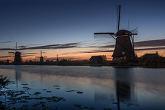 blue hour (Rafael Zenon Wagner) Tags: reflection spiegelung schatten shadow licht light windmill windmühle eveningmood abendstimmung sonnenuntergang sunset sundown nightfall dusk abenddämmerung nikon d810 sigma 35mm art romantic romantisch wasser water kanal deich blue blau orange niederlande netherlands