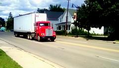 Trucking south on Highway US 41. HTT (Maenette1) Tags: truck red highwayus41 houses trees sidewalk grass clouds menominee uppermichigan happytruckthursday flicker365 michiganfavorites