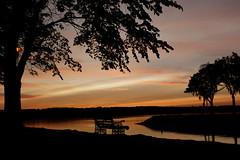 Evening mood (evisdotter) Tags: eveningmood sunset light reflections trees bench water sky colors landscape seascape sooc lemströmskanal åland