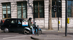 Flying Sushi (Mike Cook 67) Tags: fastfood flying fish sushi charingcrossroad london scooter fast food delivery urban roads japan cold rapid scene streetshooter panasonicgx7 pancakelens panasonic20mmlens