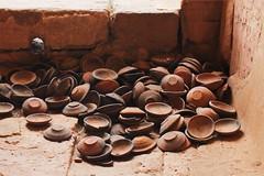 Discarded pottery (I.M.W.) Tags: myanmar pagoda paya burma birmanie bagan stupa earthquake 24thaugust2016 damage collapse building brick repair pile pot ceramic candle incense pottery